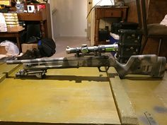 Remington 700 with Magpul hunter stock, Harris Bipod, and Vortex Strike Eagle. Custom camp paint pattern