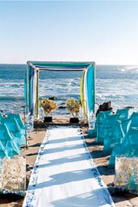 Teal and yellow... AND a beach wedding. Love the idea of draping sheers of yellow and teal over alter