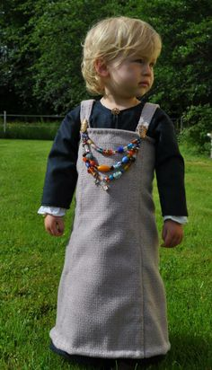 :D there may not be archeological evidence of kids in apron dresses with beads and broaches - but it's so darn cute and you know kids always want to be like mom