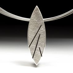 Geoffrey D. Giles jewelry silver leaf shaped pendant with a scratched surface treatment.