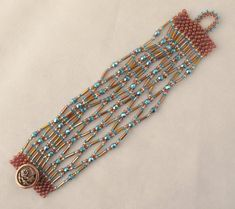 embroidery bracelets ideas Netted Alexandra Bracelet in Root Beer and Aqua Beaded Braclets, Beaded Jewelry, Handmade Jewelry, Jewellery, Beading Tutorials, Beading Patterns, Embroidery Floss Bracelets, Bugle Beads, Seed Beads