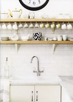 Rustic modern kitchen with white kitchen cabinets with marble countertops, subway tiles backsplash, rustic wood shelves and navy blue Anthropologie Ikat Bowls. Rustic Modern Kitchen, Kitchen Remodel, Open Kitchen Shelves, Kitchen Decor, Interior Design Kitchen, Home Kitchens, Interior Design Blog, Rustic Kitchen, Kitchen Design