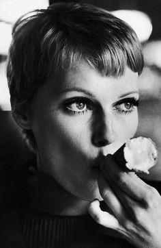 Mia Farrow getting a grip on her ice cream cone.  1977