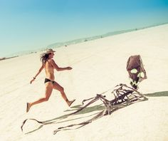 A woman chases death across the desert with a smile on her face and sandals.  #Burningman #Burningman2017 #blackrockcity #burnergirls