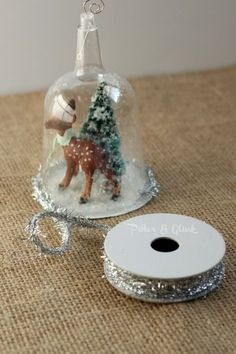 Create a beautiful snow globe ornament from a dollar store plastic wine glass! pitterandglink.com
