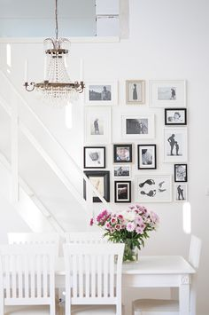 Vita villa vila-- love the arrangement of smaller black and white photos; very striking, especially in this all white room.