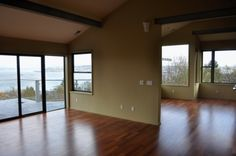 Choice Construction, Remodel, Custom Homes, Gig Harbor, Living Room, Great Room, Vaulted Ceiling, Wood Floors, Deck