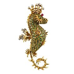 TIFFANY SCHLUMBERGER Tsavorite Seahorse Pin USA 1990 Tiffany Schlumberger Seahorse Pin. One of Schlumberger's most famous designs, the seahorse pin is set with Tsavorites, diamonds and a ruby eye. Price $28,000
