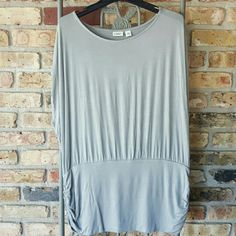 Cato sleeveless tunic Wide waistband with rouched sides, wide sleeveless arm holes. Silky gray material. Brand new. Cato Tops Tunics