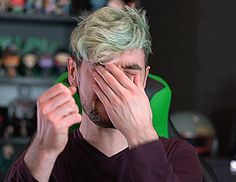 Jacksepticeye after punching himself in the face during his outro [GIF]