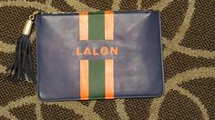 DIY Midnight Blue Faux Leather Monogram Clutch.  Orange and Green acrylic paint Center Stripe w/ Tassel and gold hardware.  Nordstrom Rack $29