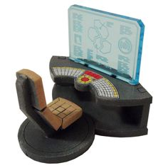BASE-0 – CONSOLES is a laser cut MDF wargaming terrain set.The set consists of 3 consoles with individually designed acrylic computer screens. The consoles fit together to form a circular table with 3 computers. Also included are separate bases for the chairs. Ideal for use as objective markers in your ...