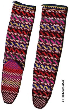 Traditional long woollen stockings.  From the Sivas province.  Ca. 1975. Two motifs used: 'mad snake' (in the more narrow bands) and a 'fish' (larger bands).  Both motifs are supposed to give protection.  (MAS museum, Ethnographical Collections, Antwerpen).
