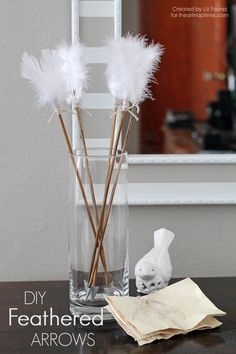 DIY Feathered Arrows... Oh my!  You never know when you might be called upon to produce these..lol lol lol LOVE THIS! So fun and pretty!