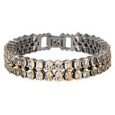 Marvelous Brace: Overdådigt på den cool måde. Smukt armbånd med citrin, der går hele vejen rundt om håndleddet og lukkes bagpå i en lås. 7149 kr.
