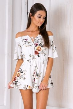 """The """"Spring fling playsuit - Pink floral"""" is a beautiful design ideal for all your summer outings! Featuring an off the shoulder neckline, elastic waist, frill hemline and cute floral print. Style it with sunnies and heels for afternoon drinks with the girls! Size 8, Length:65cm/26inches Width:30cm/12inches Polyester Cold Hand Wash Only Model wears a size 8 Model's height 180cm  Prints may vary Imported A slight variation may occur in colours and size specifications. Colours may appear…"""