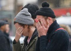 Members of the band Eagles of Death Metal, Jesse Hughes, right, and Julian Dorio pay their respects to 89 victims who died in a Nov. 13 major extremist attack, at the Bataclan concert hall in Paris, France, Tuesday, Dec. 8, 2015.  PARIS (AP) — Members of the California rock band Eagles of Death Metal