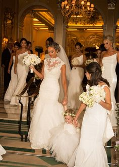 Here come the girls: Flanked by her bridesmaids and flower girls, the bride is pictured le...