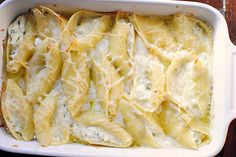 lemon-basil ricotta stuffed shells in a champagne cream sauce