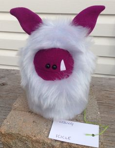 Icicle is ready for adoption. Plush hand stitched monster toy