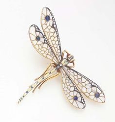 A MULTI-GEM AND ENAMEL DRAGONFLY BROOCH  Designed as a yellow and blue enameled dragonfly, enhanced by cabochon ruby eyes and single-cut diamond trim, with polished and sculpted gold legs, extending calibré-cut white opal wings, enhanced by cabochon sapphires and single and circular-cut diamond trim, mounted in gold Dragonfly Jewelry, Dragonfly Art, Insect Jewelry, Dragonfly Quotes, Beautiful Bugs, Art Nouveau, Diamond Cuts, Jewelery, Vintage Jewelry