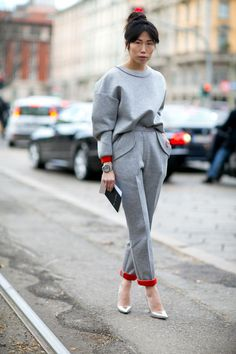 Milan Fashion Week Street Style Pictures - grey sweatshirt + grey tailored sweatpants with red lining, worn with pointy metallic heels