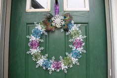 Christmas Peacock Wreath, Snowflake Wreath, Holiday Decoration, Holiday Peacock Decor, Snowflake Decoration, Purple Turquoise Green Wreath  Want a beautiful and unique Christmas wreath? We offer unique, handmade christmas decor to compliment your personal christmas scheme. Looks great from all angles.  This is one of my personal favorites! A lovely white snowflake wreath base, this wreath has a multitude of shimmering peacock-themed snowflake ornaments in purple, turquoise, and green on top…