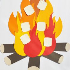 Pin the marshmallow on the campfire // woodland party game // first birthday // camping party game // woodland centerpiece