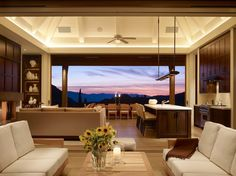 living room, kitchen and outdoor dining room with a view