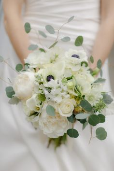 bridal bouquet of soft white blooms accented by greenery Bridalbliss.com | Washington Wedding| Seattle Event Planning and Design | Yvonne Wang Photography