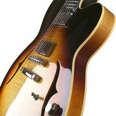 Case Guitars J3 semi-solid archtop:  A traditional semi-solid construction with a maple centre block, spruce in-fills, laminated top, back and sides; topped in exquisite, figured European maple veneers. Combined with a Brazilian mahogany neck, ebony fretboard and handwound humbuckers, this instrument has a beautiful 'woody' tone. http://www.besteno.com/questions/what-are-the-best-guitars-from-united-kingdom