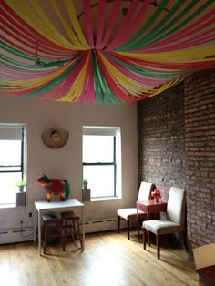 crepe paper ceiling - can be colour coordinated to match the theme.