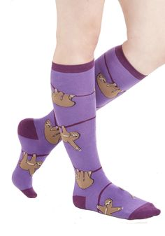 Claw-fully Cute Socks. These sloth-printed socks are ideal for a daytime date, or a casual hang out sesh! #purple #modcloth