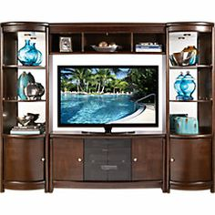 4 piece entertainment wall unit - $1,199.99 at Rooms To Go.  Saw it, wanted it, had a fit, got it.  :)