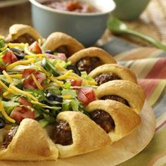 Taco Meatball Ring - Great way to change up regular tacos. Our family loves this because you can take your portion of the ring and you can pick your own toppings. Great when everyone in your family likes different things on their tacos. Mexican Dishes, Mexican Food Recipes, Beef Recipes, Cooking Recipes, Mexican Cheese, Meatball Recipes, Cooking Tips, Crescent Roll Dough, Crescent Rolls