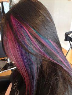 Multi colored peek a boos underneath brunette hair.                                                                                                                                                                                 More