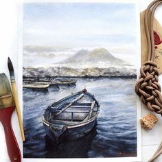 Heres a thought-provoking #watercolor #illustration by @kustova_anastasia of a row boat floating on the sea with a view of Mount Vesuvius. How many journeys began with a view similar to his one? The great volcano rests in the distance beneath a veil of mist and fog and a thin layer of clouds covering the sky letting in light to bounce and refract off the water to cast grays and blues on the boats. As the water ripples the reflecting light bends and produces different colors throughout its…