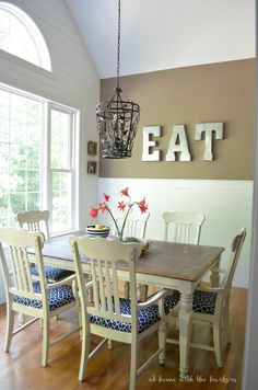 DIY Planked Walls and Painted Cabinets make this kitchen makeover affordable and GORGEOUS!