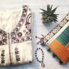 Beautiful folk embroidery DIR69 short summer dress and kantha clutch....available online  #DIR69 #boho #Bohobabe #bohogypsy #gypset