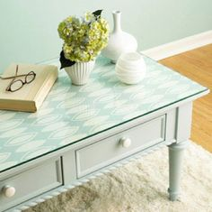 DIY Inspiration - Using Wallpaper under Glass to freshen up a desk or coffee table. Great way to change up decor seasonally... Or when you're bored!