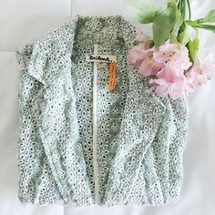Anthropologie Taikonhu Blazer, Green Floral Eyelet Beautiful light-weight women's cotton blazer. Purchased at Anthropologie, Taikonhu brand. A floral eyelet material. Size 2. Sits right at the hips. Anthropologie Jackets & Coats Blazers