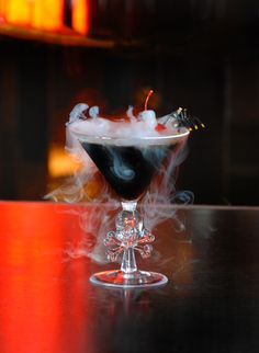 Black Magic Cocktail Recipe: 1 ½ ounces Vanilla Vodka and 1 ½ ounces Patrón XO. Serve chilled in a martini glass and garnished with a cherry. Dry ice optional
