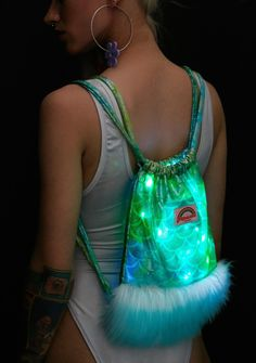J Valentine Aqua Mermaid Light-Up Mini Backpack you wanna be where the people are, you wanna see 'em dancin! Show off yer splashiest dance moves with this flashy mini backpack featuring a metallic mermaid-scale fabric construction, contrasting 2-tone faux fur, 2 LED light strands and drawstring closure.