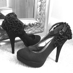 Black satin rosette heels Timeless black satin heels with rosettes on back and ankle strap. Worn only a handful of times. Purchased in a boutique in Asheville, NC Lovely People Shoes Heels
