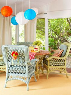 This screen porch gets a punch of color from bright furniture and accessories that can withstand the elements. Colorful outdoor-grade wicker chairs and zippy vinyl lamps that mimic paper party lanterns pop against the white walls and window treatments. Decor, Wicker Decor, Outdoor Decor, Painted Furniture, Outdoor Rooms, Home Decor, Indoor Porch, Diy Outdoor Furniture, Painting Wicker Furniture