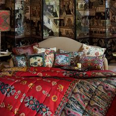 Infuse your home with elegant design with this set of three Timur cushions from Etro. These cushions feature a different whimsical tropical motif on each cushion including lions, tigers, giraffes and