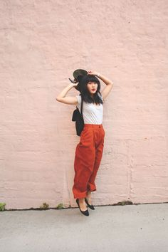 JennifHsieh Late Summer #Outfit   Olive Green Hat, White T-shirt, Black Mini-Backpack, Burnt Orange Wide-leg Trousers