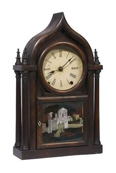 Terry and Andrew four columned gothic beehive clock