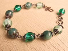 Spring green antiqued copper wire wrapped por SabineMichaelJewelry