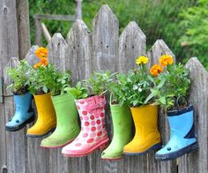 Little boots garden, you could use outgrown boots as kids grow up and the little garden could be their responsibility.